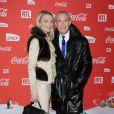 Jean-Claude Jitrois et Sarah Marshall lors d'une soirée au profit de l'association Petits  Princes et de  lancement du train rouge Coca Cola, le 15 décembre 2011, à  Paris