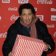 Smaïn lors d'une soirée au profit de l'association Petits  Princes et de  lancement du train rouge Coca Cola, le 15 décembre 2011, à  Paris