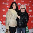 Marc Cerrone et sa femme lors d'une soirée au profit de l'association Petits  Princes et de  lancement du train rouge Coca Cola, le 15 décembre 2011, à  Paris