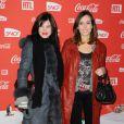 Delphine Chanéac et Leslie Coutterand lors d'une soirée au profit de l'association Petits  Princes et de  lancement du train rouge Coca Cola, le 15 décembre 2011, à  Paris