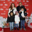 Francis Perrin et sa famille lors d'une soirée au profit de l'association Petits  Princes et de  lancement du train rouge Coca Cola, le 15 décembre 2011, à  Paris
