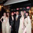Christian Louboutin entouré des danseuses du Crazy à la première VIP de la revue  Feu  du Crazy Horse, à Paris, le 12 mars 2012.