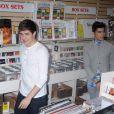 Liam Payne et Zayn Malik de One Direction dans un magasin de disques new-yorkais, le 12 mars 2012.