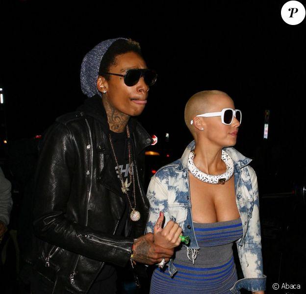 Amber Rose et son fiancé Wiz Khalifa sortent d'un concert des Guns N' Roses à Los Angeles le 12 mars 2012