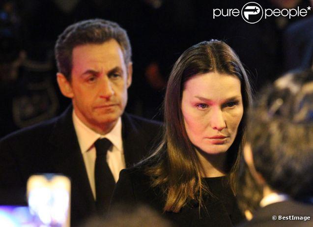 Carla Bruni et Nicolas Sarkozy le 19 mars 2012 à la synagogue Nazareth de Paris lors d'un hommage rendu aux victimes de la tuerie de Toulouse