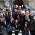 Claire Nadeau et Zoé Bruneau, en compagnie de Luis Rego lors des obsèques de Philippe Bruneau le 3 avril 2012 en l'église Saint-Ouen de Caen